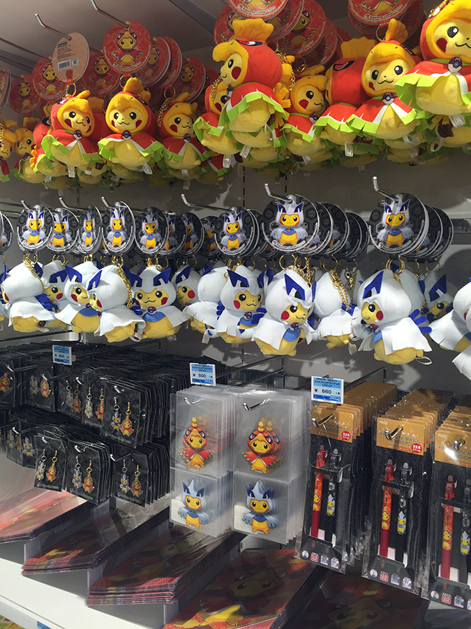 And for people who dont like plush there were a couple other items featuring the lugia and ho oh poncho pikachu artwork including stickers